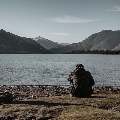 man sitting by water.jpg