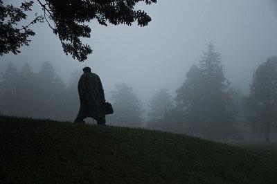 man holding bag in trees-min-min.jpg