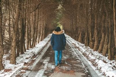 man walking in woods with sonw-min.jpg