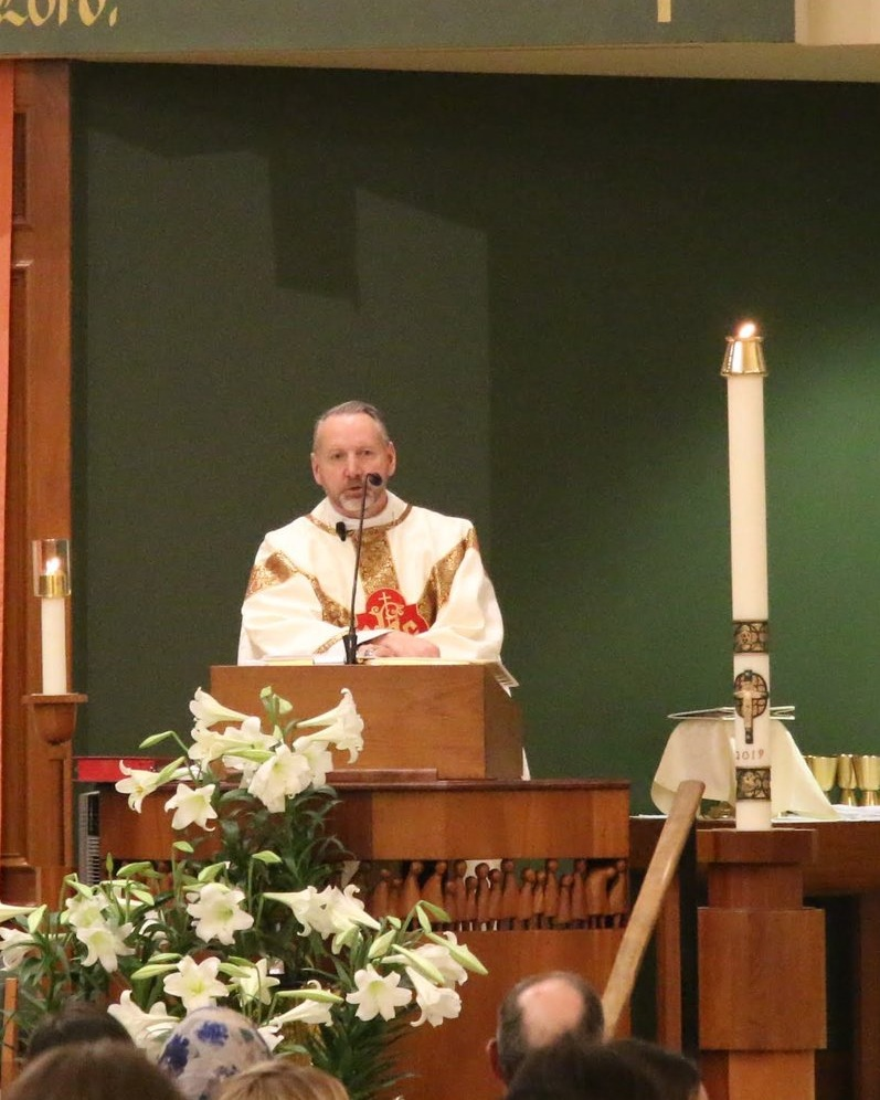 Our pastor Fr. Michael Goodyear giving a homily.