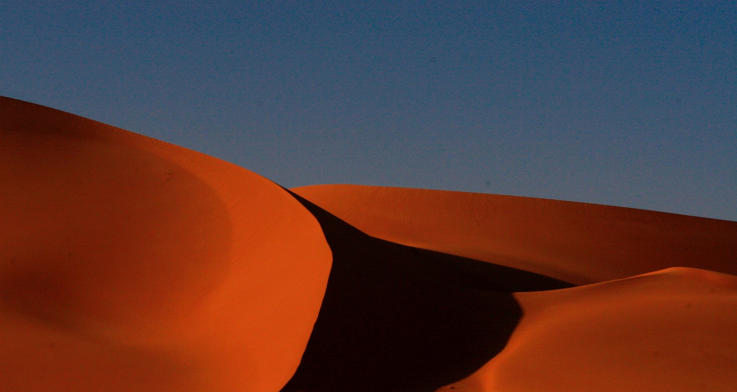 Dunes in Murzuq, Libya, Photo by    Audrius Sutkus    on    Unsplash   .