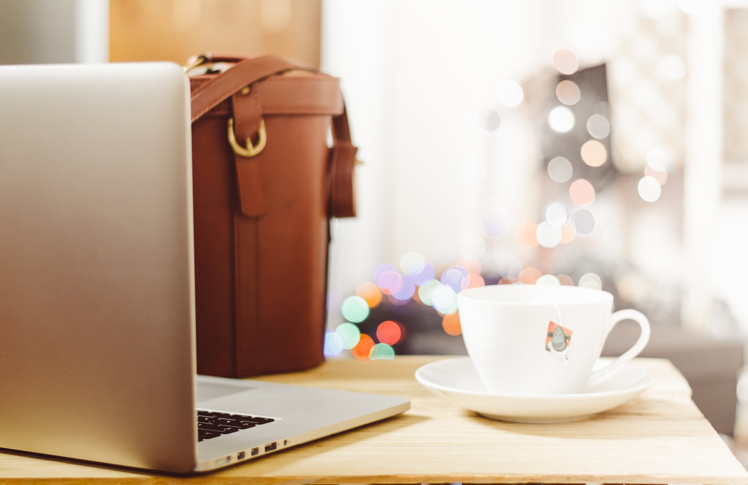 An image of a laptop and a cup of tea to symbolise the operations and business procedures at Hygge Me Global.