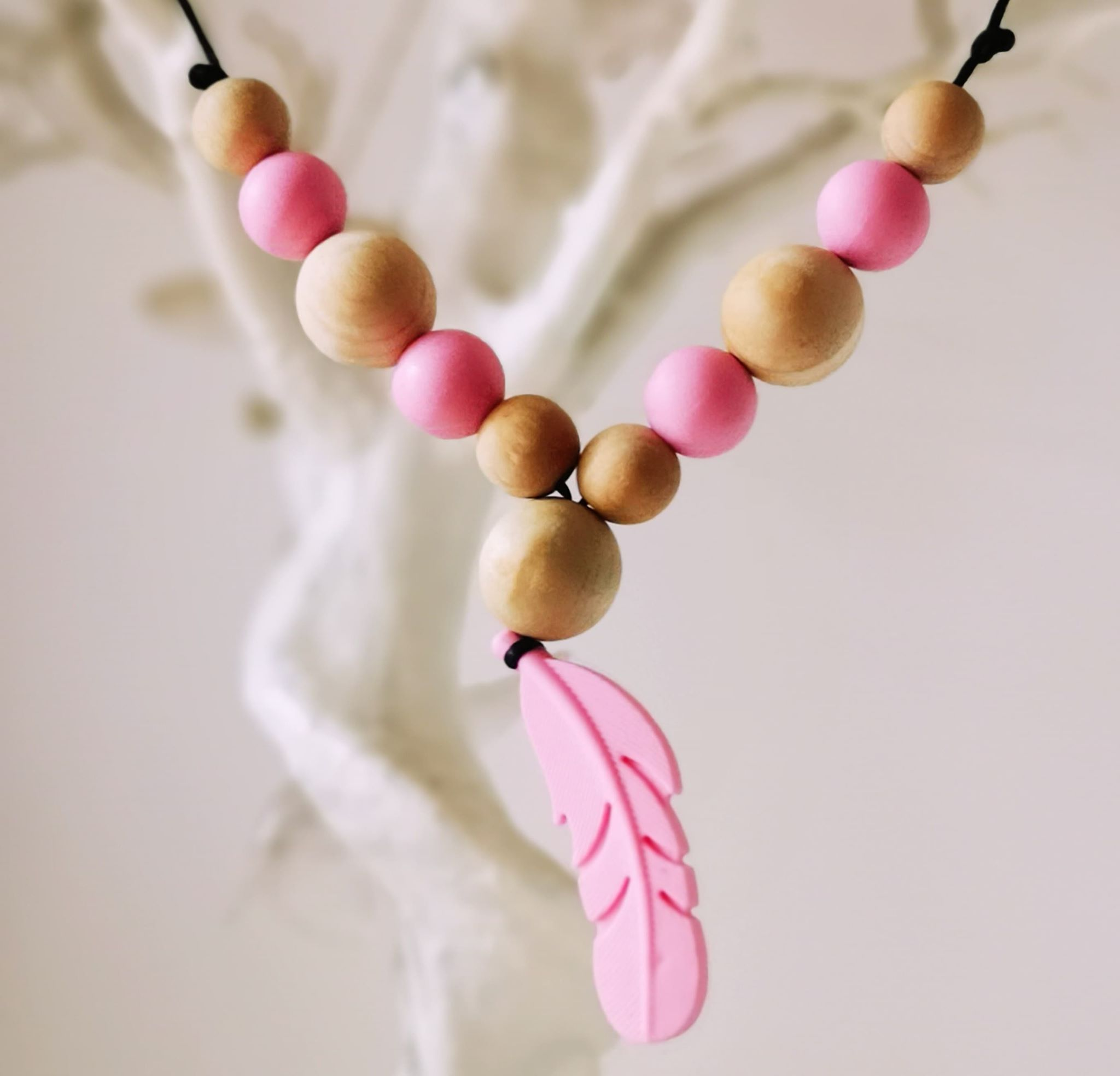 fetaher pink new.jpg