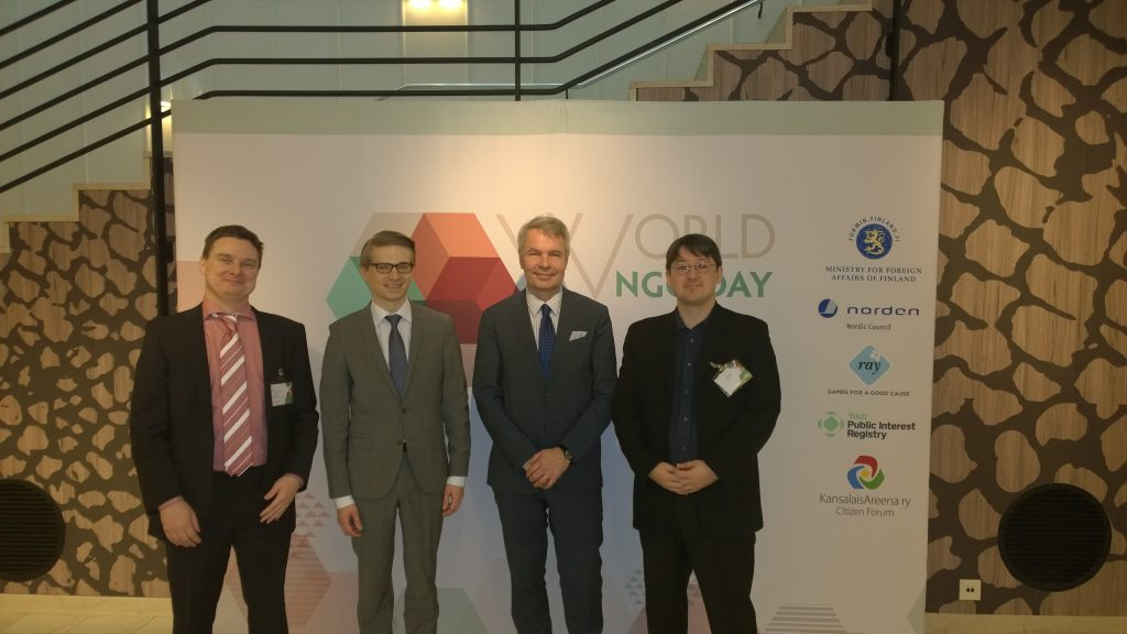 Tom with business partner Ykä Marjanen at World NGO Day, together with the Finnish Minister of Development Pekka Haavisto and the Founder of World NGO Day Marcis Liors Skadmanis