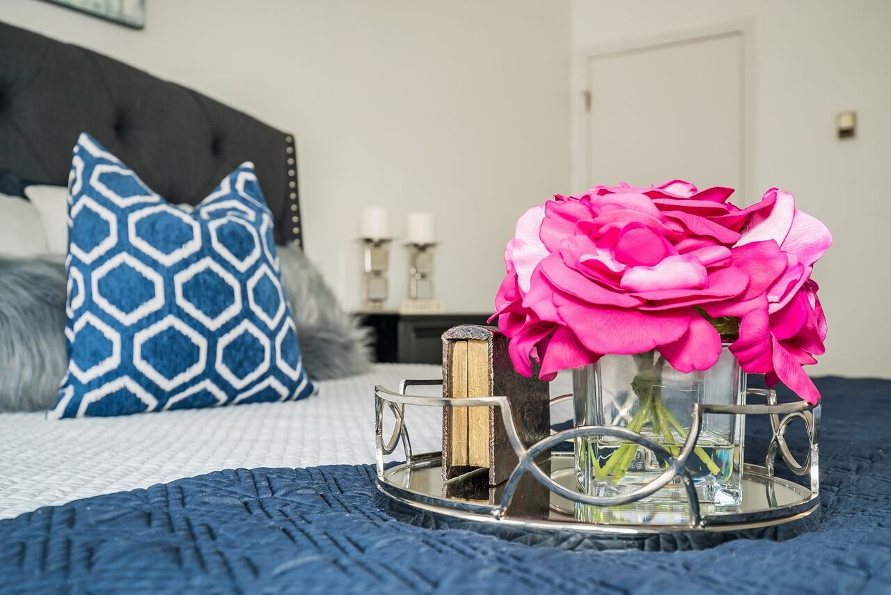 spaces-that-speak-home-stagers-fortlee-nj-bedroom-flowers.jpg