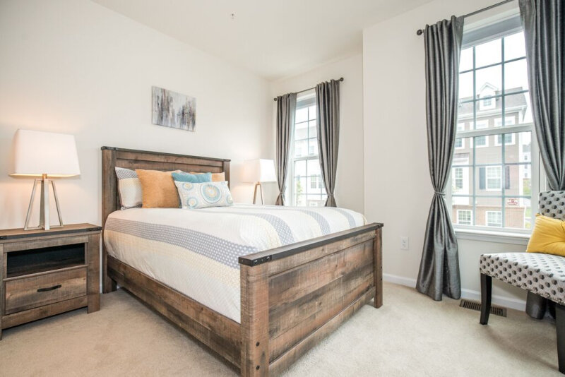 spaces-that-speak-home-staging-woodbridge-nj-wood-bedframe-light-toned-bedroom.jpg