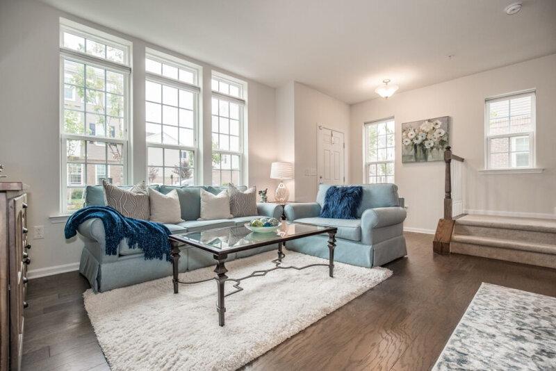 spaces-that-speak-home-staging-woodbridge-nj-open-concept-living-room-hardwood-floors.jpg
