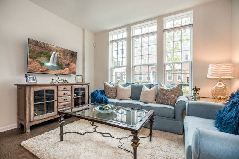 spaces-that-speak-home-staging-woodbridge-nj-living-family-room-furniture-coffee-table-open-concept.jpg