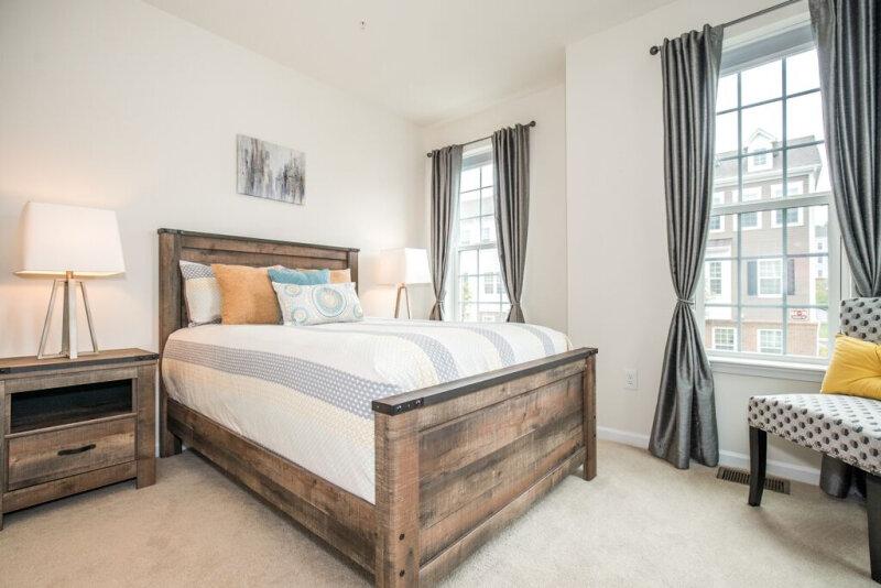 spaces-that-speak-home-staging-woodbridge-nj-wood-bedframe-light-toned-bedroom.jpg