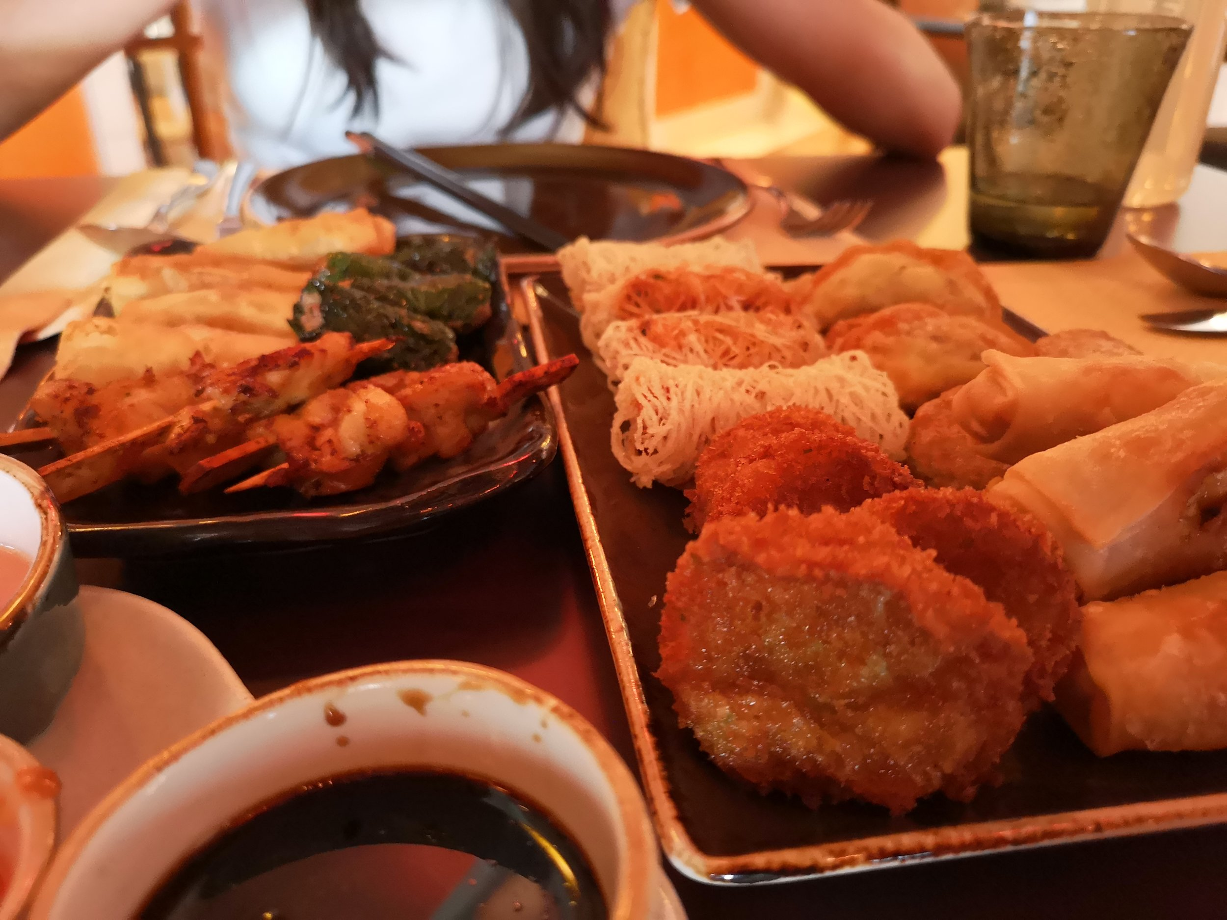 The Cha Ca is the most prominent dish you see. Nearest dish to the camera (right plate left bottom)
