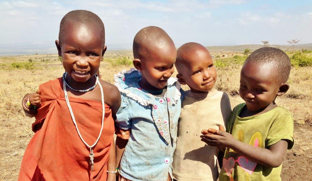 Olmoti children receive the rabies vaccine.
