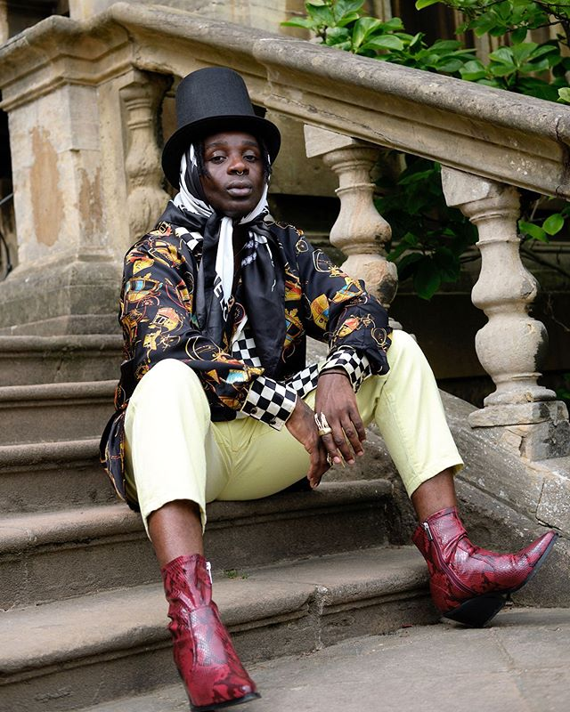 You can lounge comfortably in your own luxuries,  looking up to me. Styling & Model: @ramariochevoy  Shirt & Pants: @versace • Scarf @chanelofficial Shoes: @topshop & vintage hat: @suerydercharity