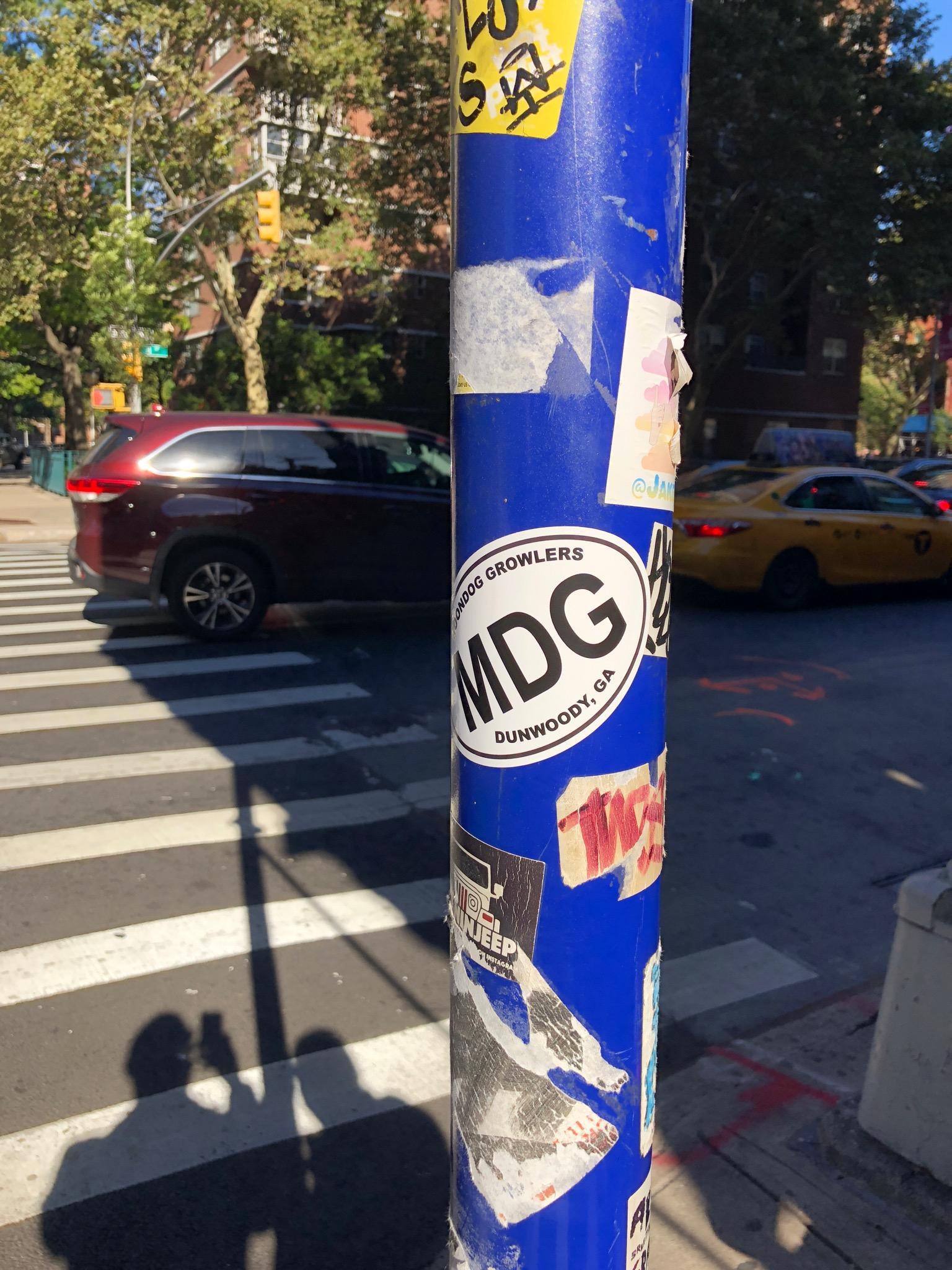 MDG sticker on a poll in Brooklyn, NYC