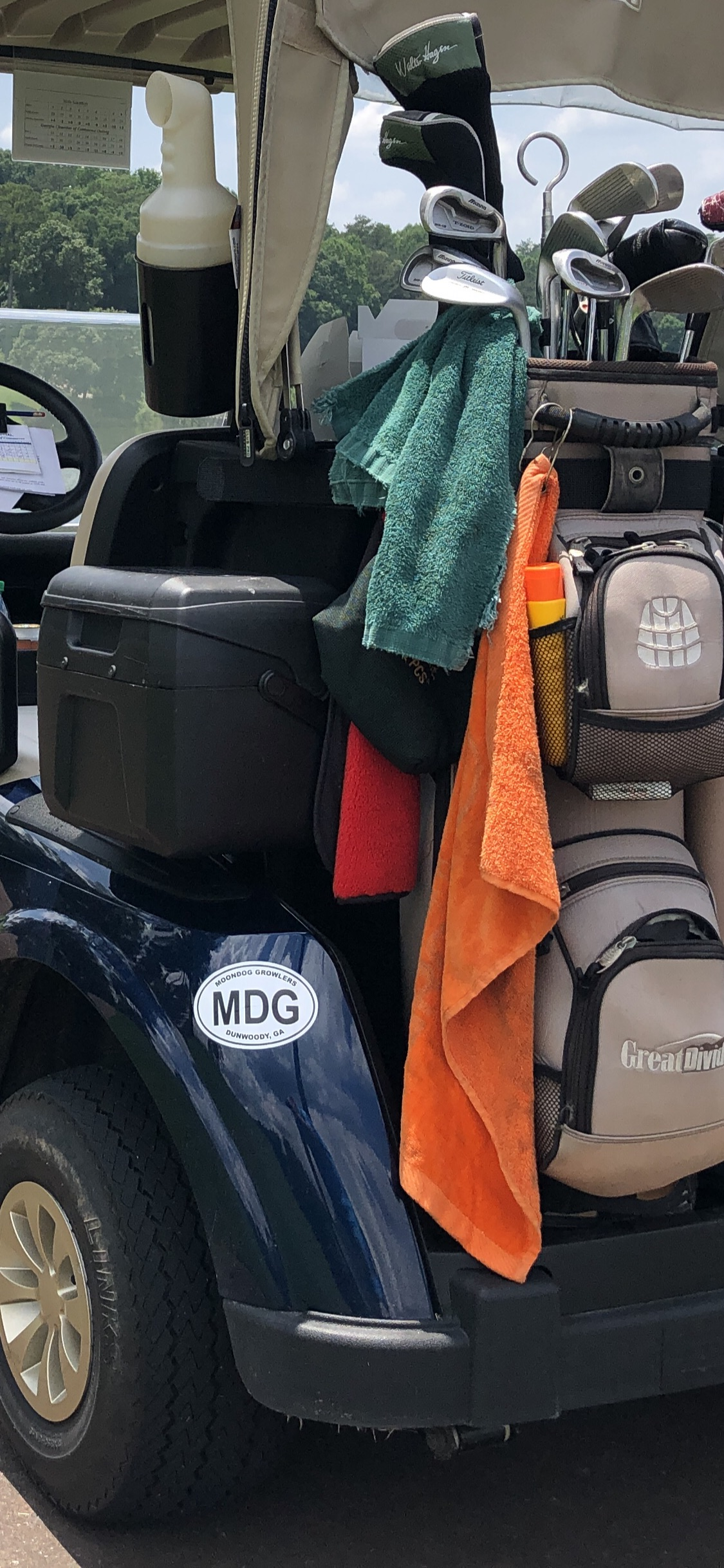 MDG logo on a golf cart at a local country club