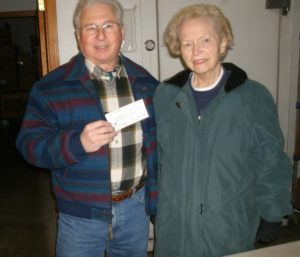 - Bob Rubino presents check to Pat Houk, Coordinator for the St. Joseph Food Pantry