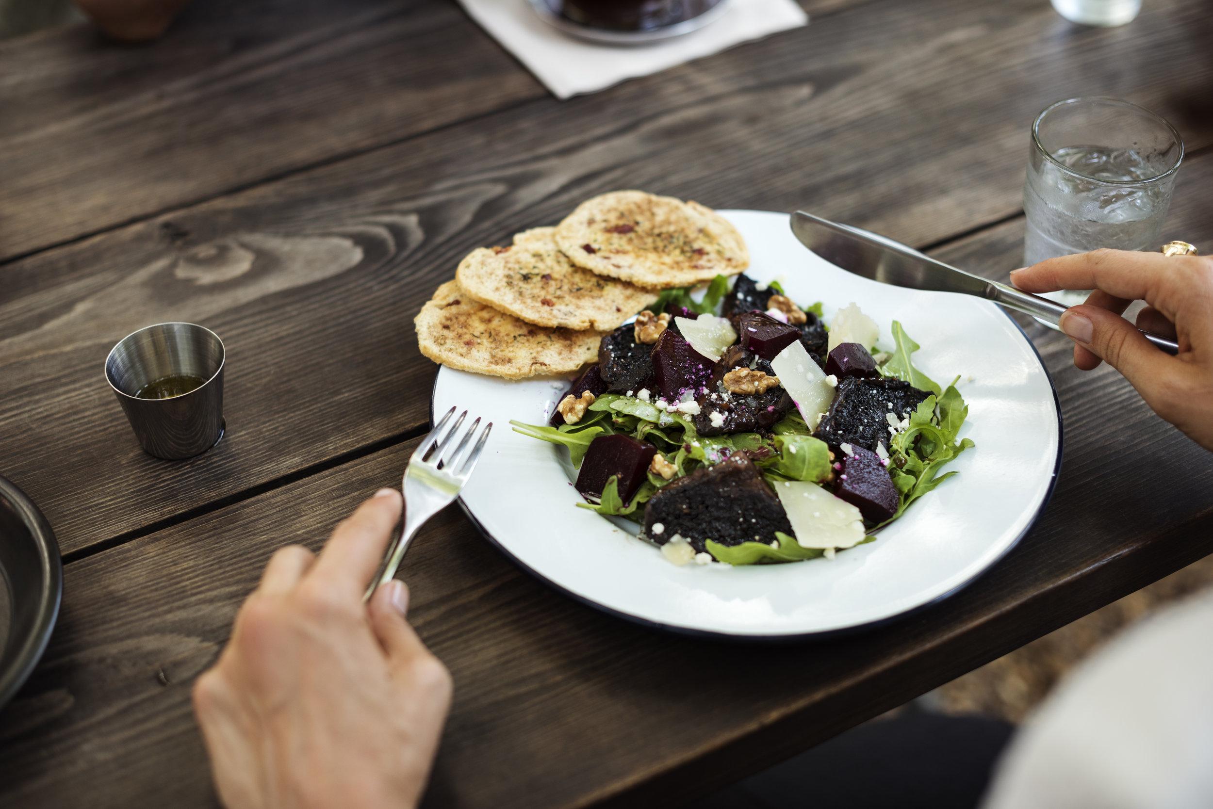 Beet and arugula salad with shredded pumpkin seed parmesan