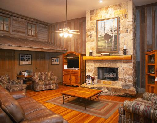 Big Bird Lodge - Big Bird Lodge has an incredible gathering room with a beautiful stone fireplace, re-claimed hardwood floors, comfortable seating, and a kitchenette. There are 10 bedrooms, each with a private bath. 5 of the rooms have 1 queen bed and 5 of the rooms have 2 queen beds. There is a meeting/common space that can hold up to 20 people for a meeting. [Accommodates 10-30 people]