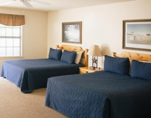 Pecan Suites - Pecan Suites are 12 individual spacious suites with private entrances to the outside. Each room has 2 queen beds, a private bath, and a kitchenette area. The rooms at Pecan look out to the rec field, making it a great, central location. [Accommodates 12-48 people]