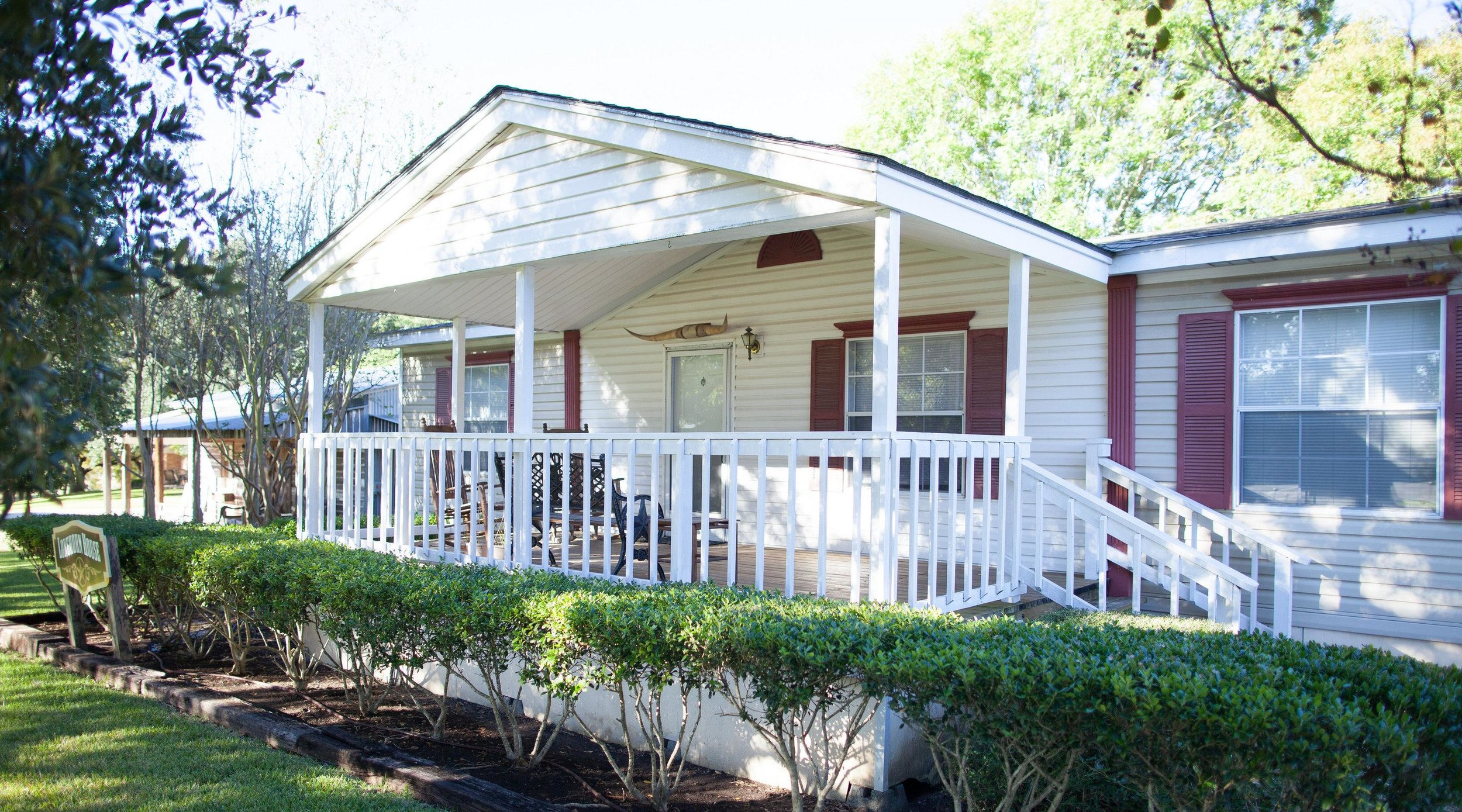 Longhorn Cottage - Entire house · 3 bedsLonghorn Cottage has 3 bedrooms, 2 baths, a large living room, kitchen, dining room, and a covered front porch with rocking chairs for your enjoyment. Longhorn is a good fit for small, close-knit groups getting together. [Accommodates 3-6 people]