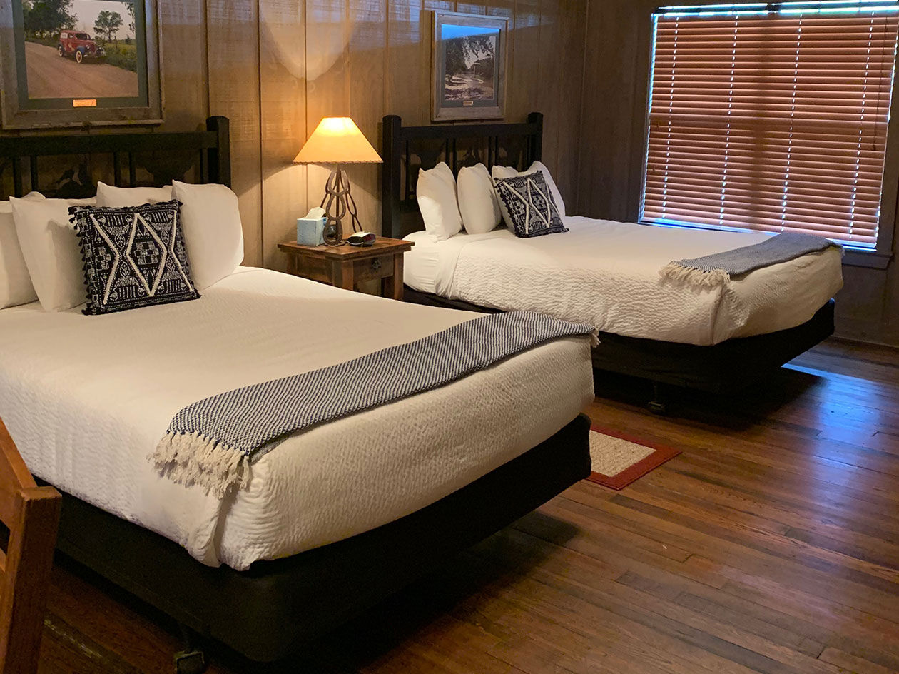 Chisholm Trail Suite - Chisholm Trail Suite is a large one bedroom suite with 2 queen beds, a private bath, and a kitchenette. The beautiful re-claimed hardwood floors bring out the rich history of Summers Mill. [Accommodates 1 to 4 people]