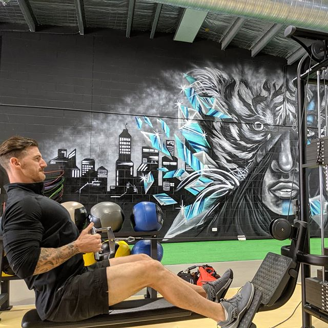 Coby @impactstrengthaus 😰 warming up 💪 on the low row, new cable supplied and fitted by @gymfix_sunshine_coast! 😍 The artwork!