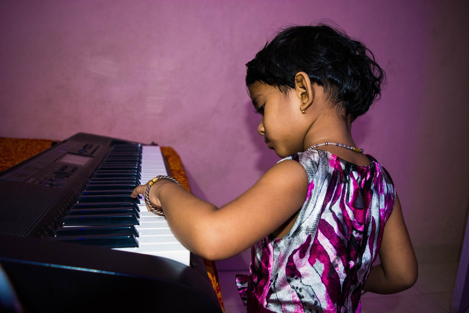 cute-girl-playing-piano-1628763_1920 copy.jpg
