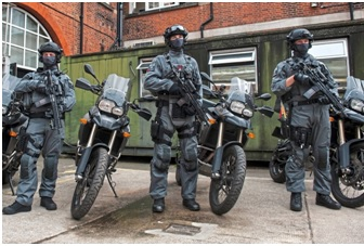 Kevlar-clad CTSFOs stand beside their new fast response motorcycles in this 2016 publicity shoot (London Evening Standard)