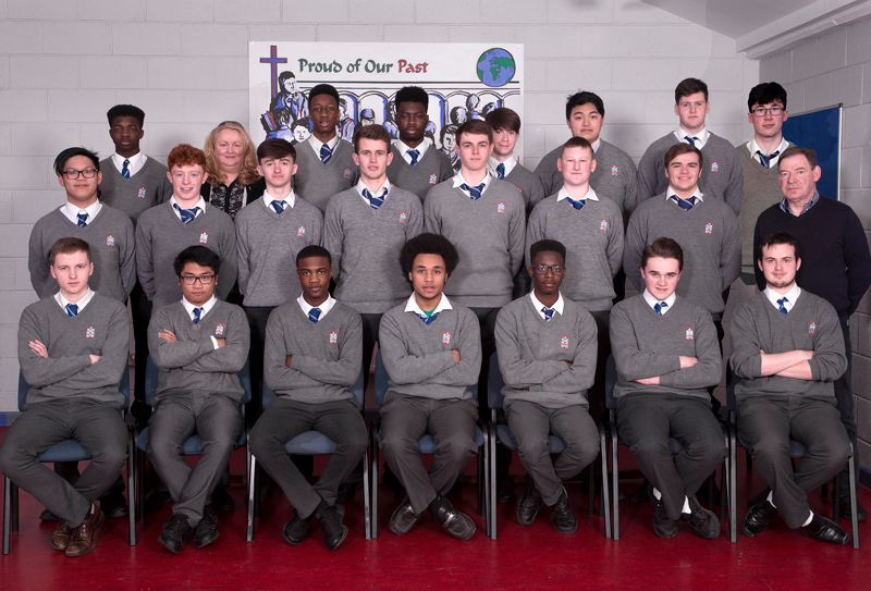 6.1 2018 Class   Back row: Fawwaz Kekere-Ekun, Ms McGowan, Ryan Benedo, Handsome Agunloye, Emmet Kerr, Tien Dinh Dinh, Christopher Whelan, Cathal Doherty.  Middle row: Joe Linogao, Anthony Kent, Zach Keller, Alan Connor, Dan McCabe, Eoin Reilly, Dylan Matthews, Mr Stephenson.  Front row: Alexsandrs Kurtiss, Mark Queypo, Joshua Sokan, Noah Ajayi, Olajuwon Dele, Craig Sawyer, Josh Reilly.