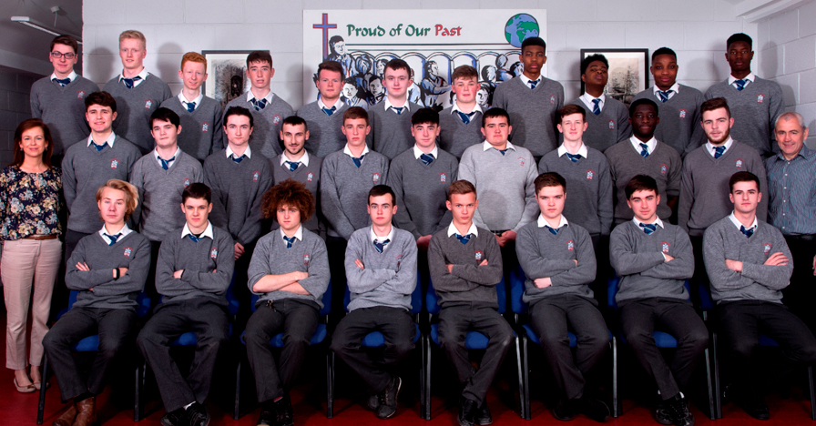 6.2 2017 Class   Front Row: Michael Janik, Brian Mooney, Anthony Canny, Andy Loughran, Will Murphy, Dylan Floyd, Ruairi Eustace, Joseph Corrigan.  Middle Row: Ms. Fiona Radford – Form Tutor 6.2, Luke McGuinness, Oisin Doherty, Cian McCluskey, Dillon Byrne, Harry Haughney, Ben Gerrard, Sam McGrane, Jordan Reynolds, Enock Sarfo Amankwah, Jack Teelan, Mr. Jim Matthews – 6th Year Head.  Back Row: Shane McQuillan, Euan Reid, Jason Nolan, Conor Morgan, Ronán Brown, Kenneth O'Donovan, Aaron Kierans, Panashe Marata, Andre Chitambo, Joel Safo, Emmanuel Olagbaju.