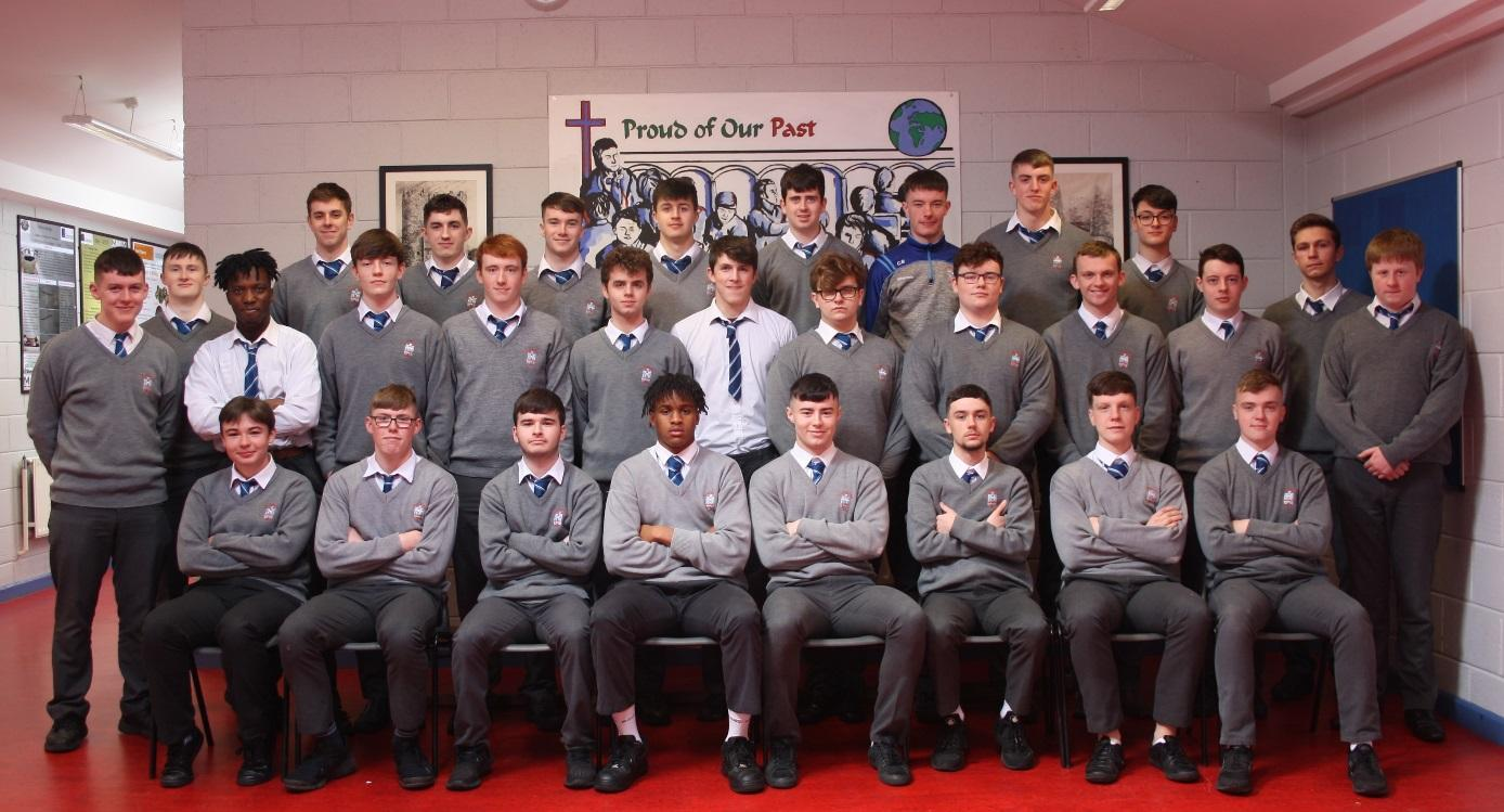 6.4 Class 2019    Front row (L-R):  Jack Kennedy, Matthew O'Reilly, Andrew Boylan, Denzel Ebose, David Lally, Andrew Collier, Evin McConnon, Connel Rice   Middle row (L-R):  Luke McCarthy, Jack Hodgins, Rodney Omosigho, Ronan O'Gara, Daniel Gibbons, Robert Kinch, David Dwyer, Ross Quigley, Harry Lipscomb, Seán Carolan, Conor Reynolds, Luke Callaghan, Callum Thomson   Back row(L-R):  Aaron Stone, Neil Holdcroft, Michael MacMahon, James Farrell, Peter Finegan, Ciarán Brennan, Adam Booth, Kenneth Fallon   Absent:  Jordan Kelly