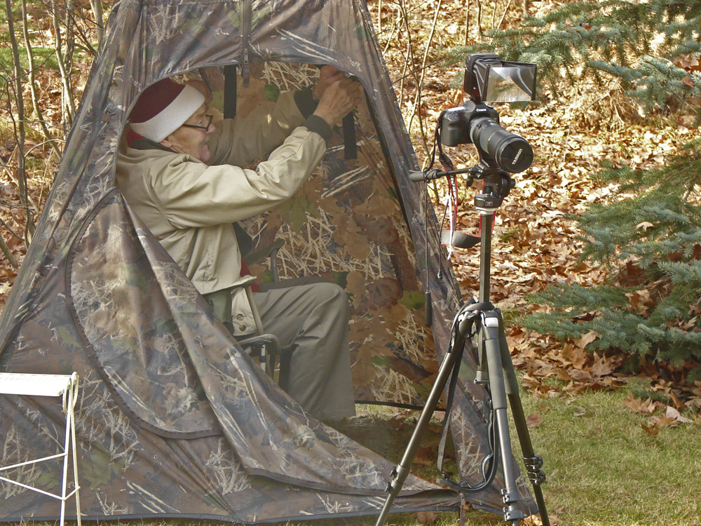 My Dad, age 81, getting ready to photograph birds near the feeders