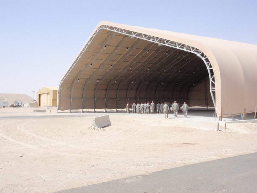 Shelter Structures worked together with a local contractor in Kuwait to put together the winning competitive bid to build this 150′ W x 130'L x 46′ H building.                                                          It was erected in Kuwait to support the USAF operations in Iraq.