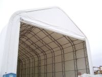 Rocky Mountain Prestress 65'W x 140'L x 52'H, with a 54'W x 34'H door. Provides covered space for winter precast operations.