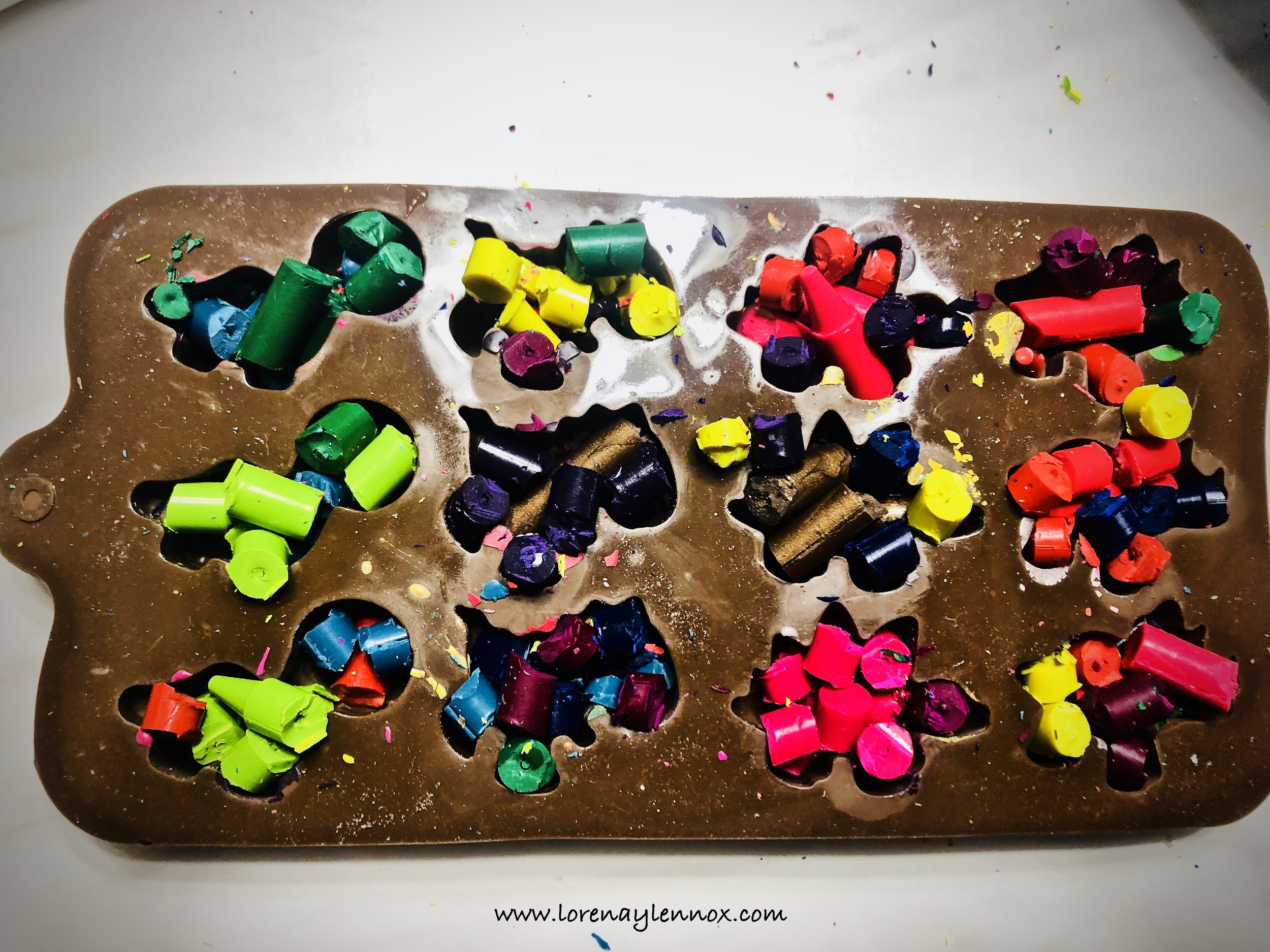 Fill your molds up as much as possible. With the crayon debris, I filled in the extra nooks and crannies.