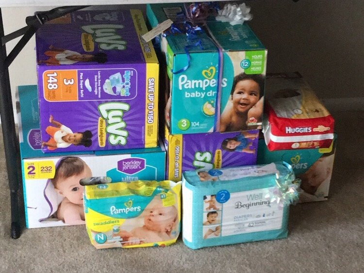Gender reveal party on a budget. Diaper stockpile. Diaper Raffle