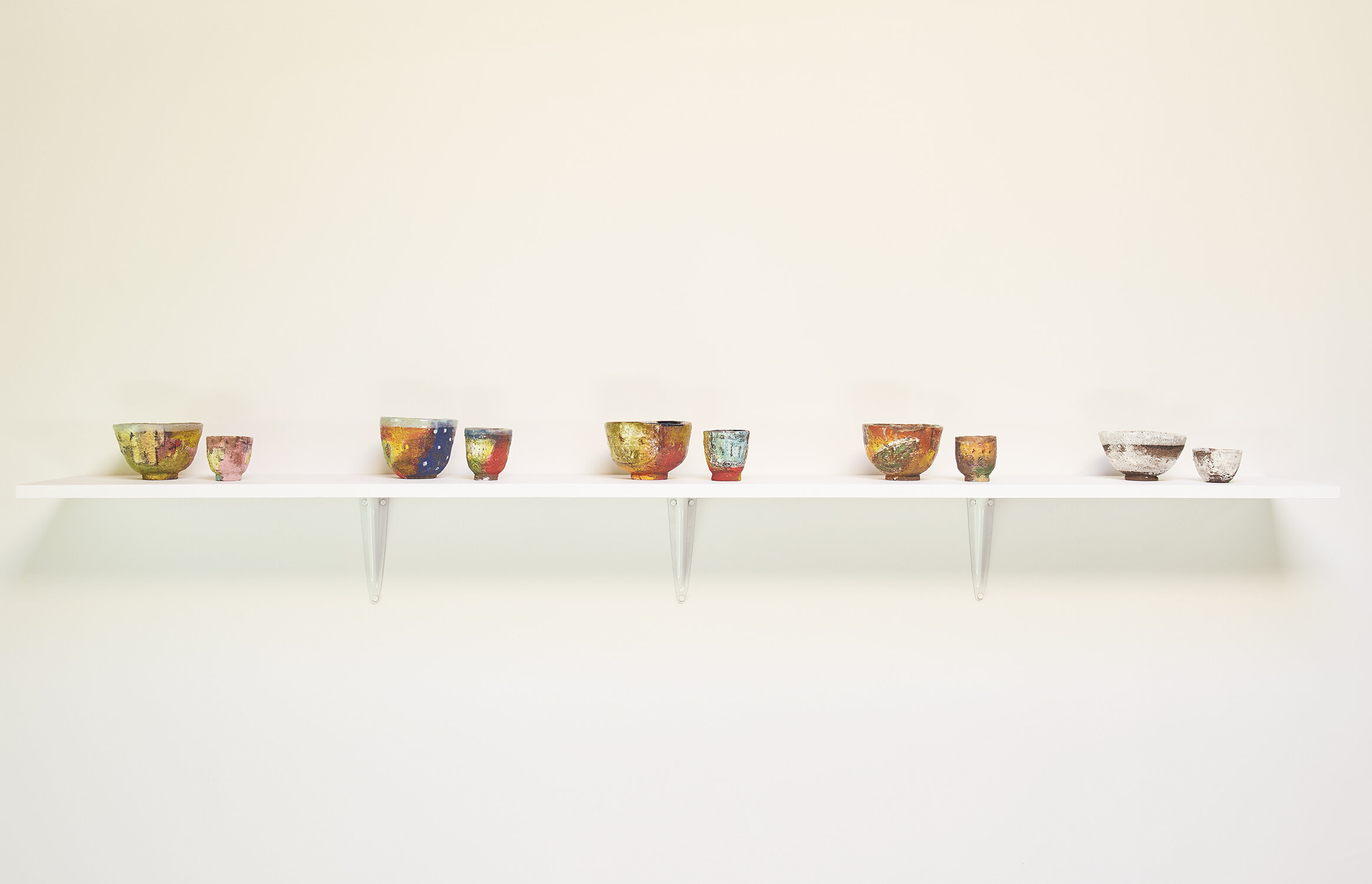 Shino Takeda From left:  Spring, Summer, Indian Summer, Autumn, Winter , all 2019 Traditional Japanese tea bowl and sake cup sets ceramic, slip, underglaze, glaze Tea bowls all approximately 3 ¼ × 5 ¼ × 5 inches (8.26 × 13.34 × 12.70 cm) Sake cups all approximately 2 ⅝ × 2 ½ × 2 ⅞ inches (6.67 × 6.35 × 7.30 cm)