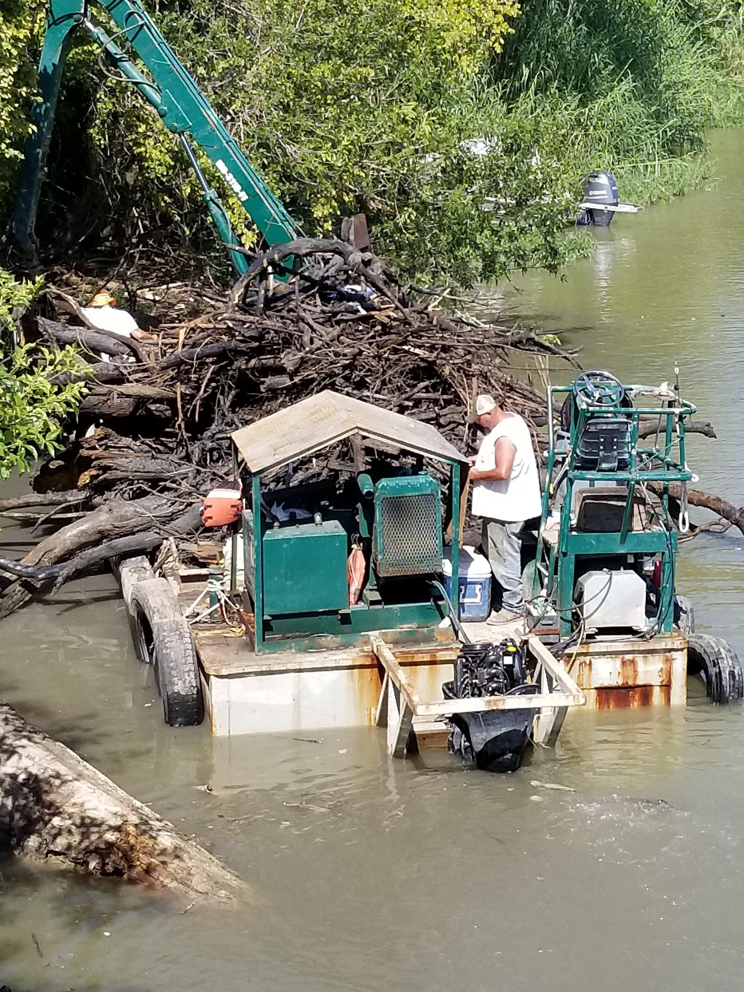 Creek clean up & dam debris extraction -