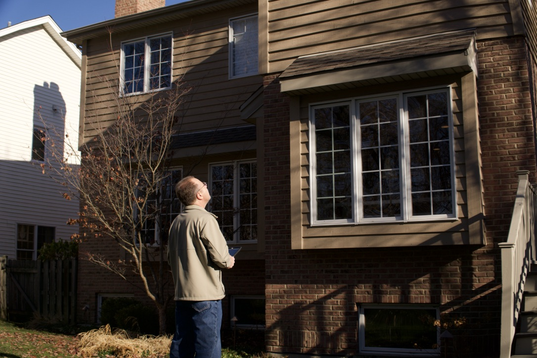 I walk the grounds of the property, doing a visual inspection. Items I am looking at include: drainage, landscaping growth, siding, gutters, power lines, and many other areas of possible concern.