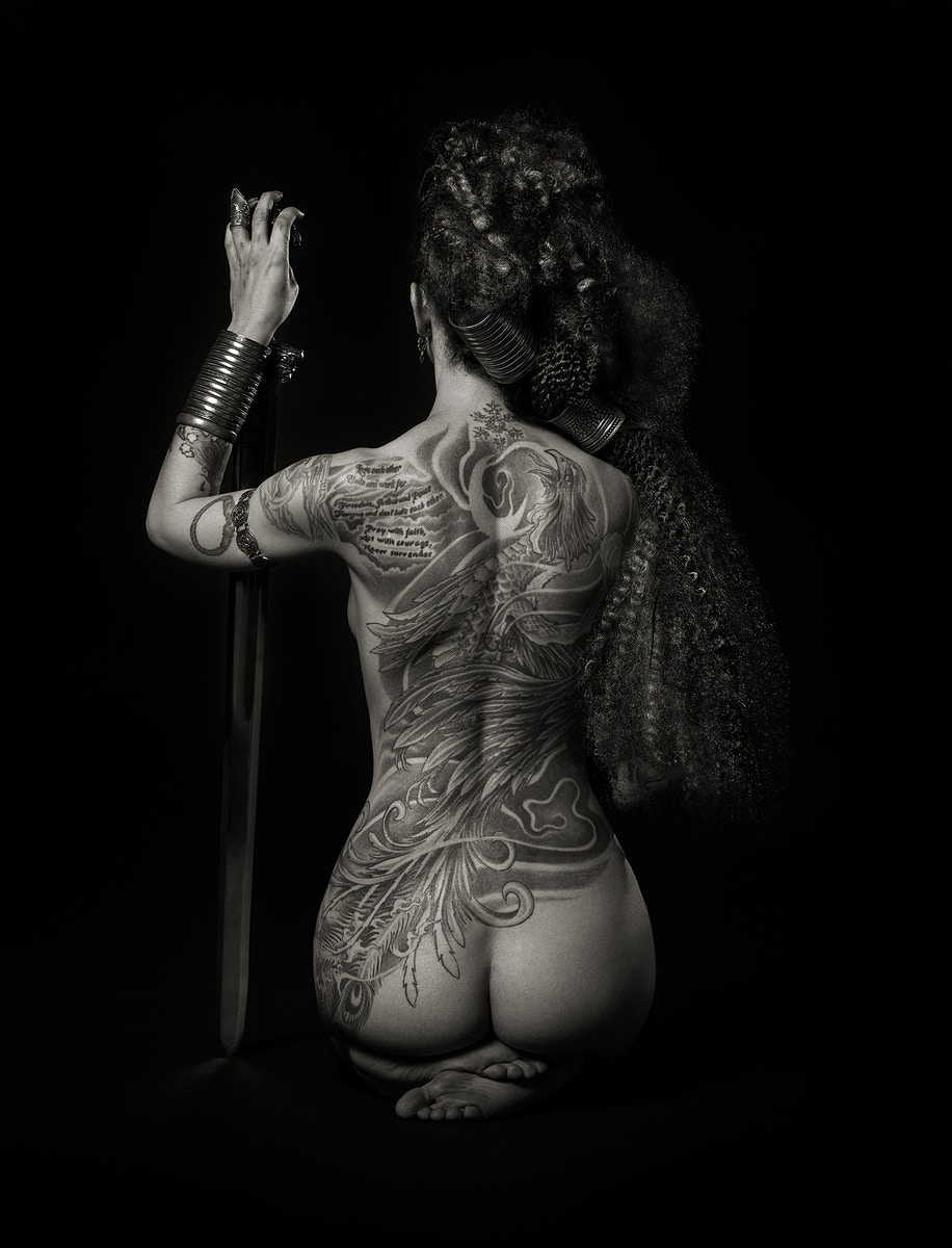 Reka Nyari | Valkyrie Ink    April 2019 - May 2019 | The Gallery   In collaboration with Coldstream Fine Art, we are thrilled to present Valkyrie Ink, an exhibition from Reka Nyari, whose black-and-white photography has been widely recognized for its bold yet elegant treatment of the feminine form.   Valkyrie Ink follows Geisha Ink, a series of work also focusing on a young woman defiantly clad in tattoos, but introduces Eowyn and her story of trauma and recovery. Eowyn's difficult journey is elegized through her skin, which is marked not only by tattoos but also through scars—all sediments, deliberate or not, of a personal history.
