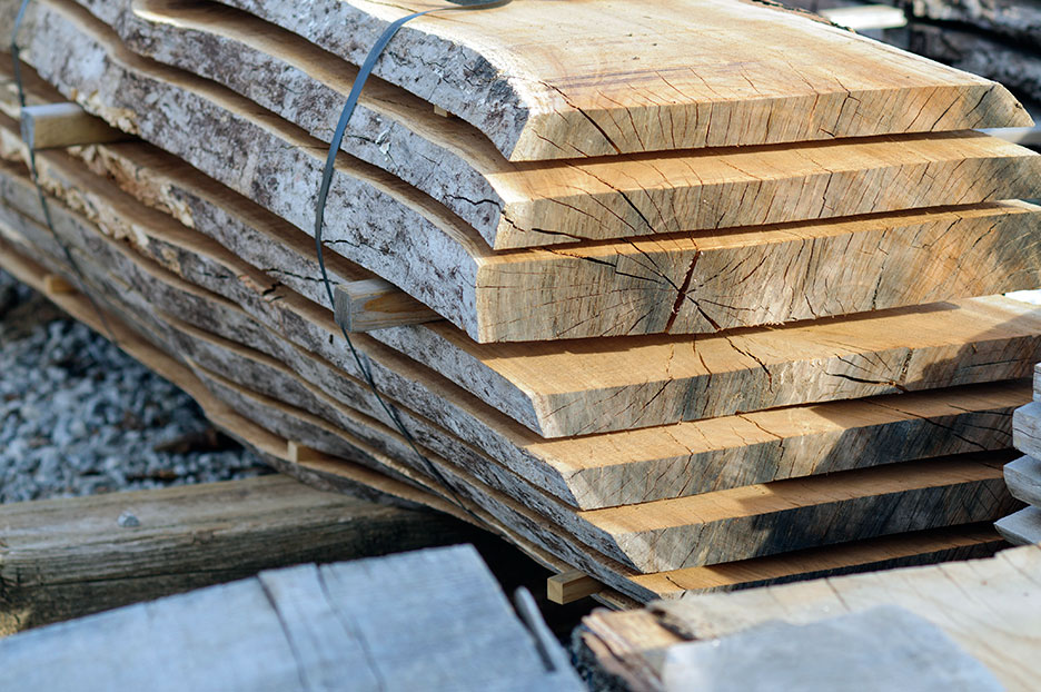 """Lumber/Wood - We offer a wide selection of reclaimed wood beams in a variety of dimensions and hues. Perfect for fireplace mantels and Tuscan- or Spanish-style wood ceiling beams. Reclaimed dimensional lumber is sold """"as-is,"""" with no alterations and can be requested by dimension, depending on available stock. Our rough-sawn, reclaimed lumber is not finished before sale, often is less costly and allows you to control how the wood is finished."""