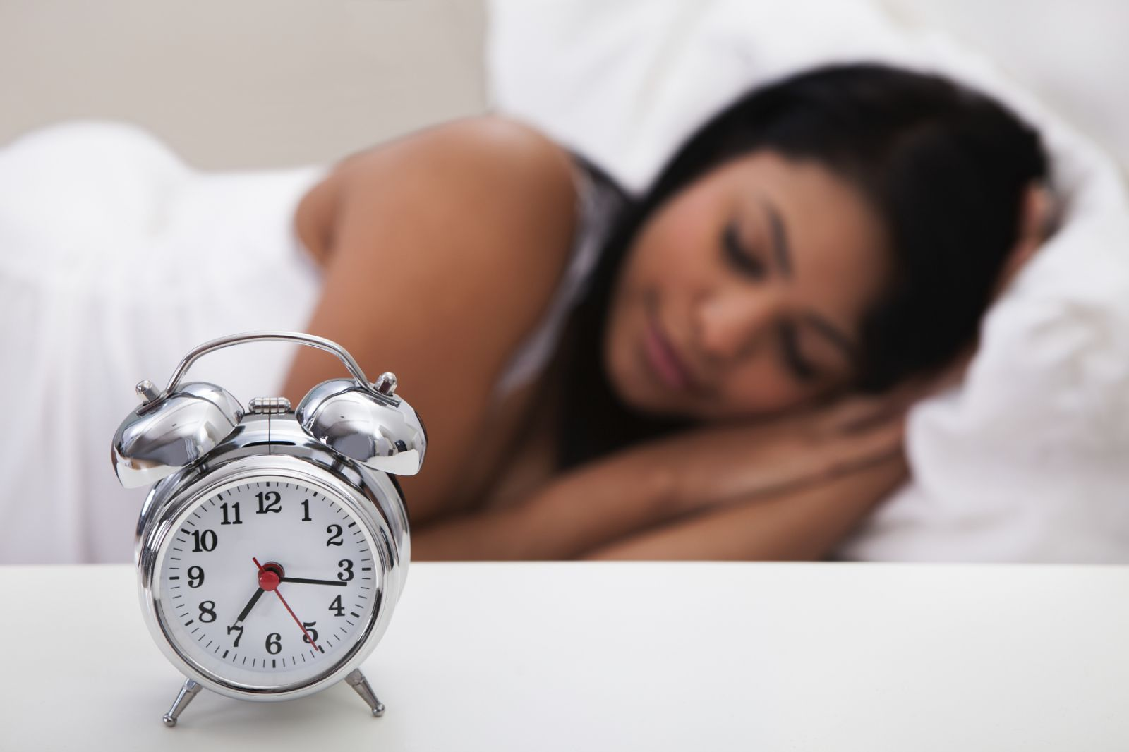 sleep-clock-sleeping-woman.jpg