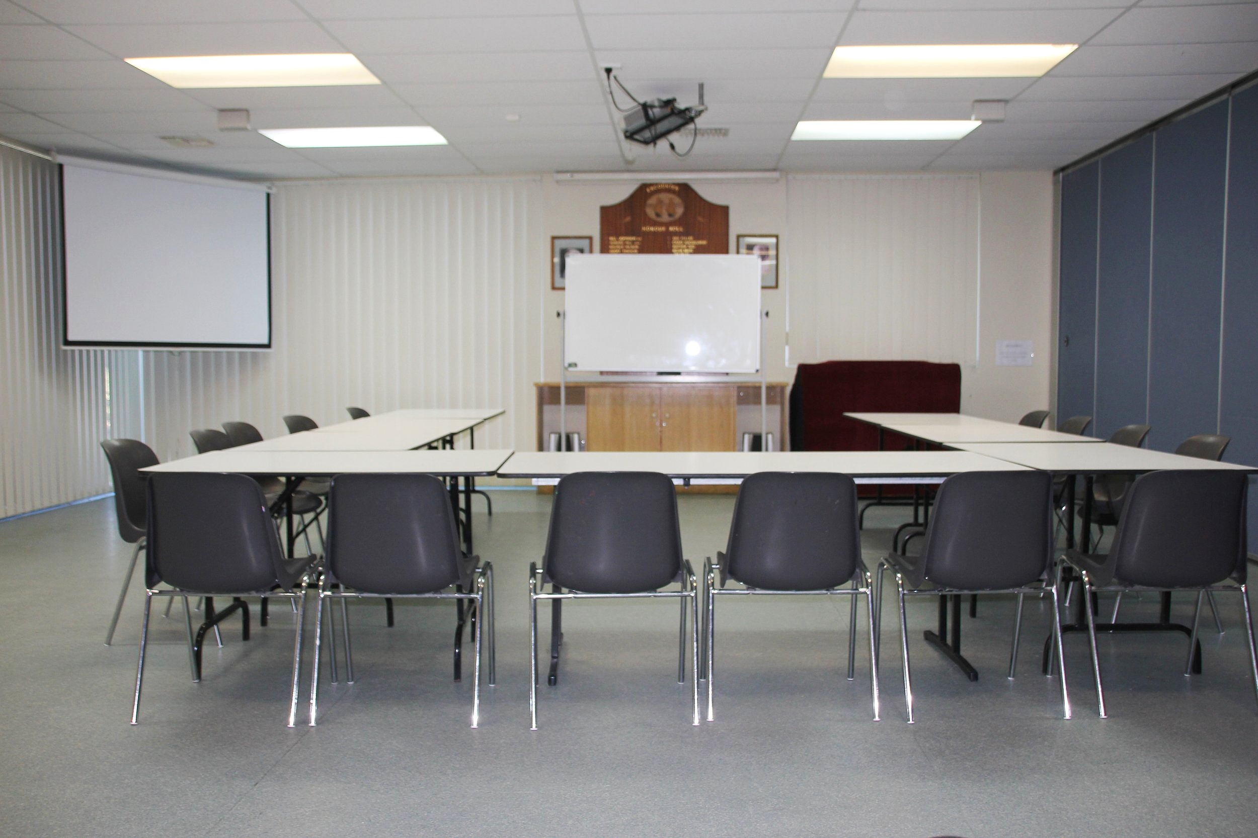 Room set up in U-shape for a conference