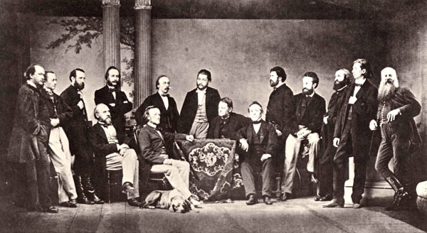 Wagner (sitting centre left) and friends around the time of the premiere of  Tristan und Isolde . While Hans von Bülow (standing behind Wagner) was relentlessly rehearsing the ensemble for the opera partially inspired by Wagner's affair with Mathilde Wesendonck a few years ago, Wagner himself was having another affair with Mrs. Bülow, better known as Cosima Wagner later in music history. Talk about drama...