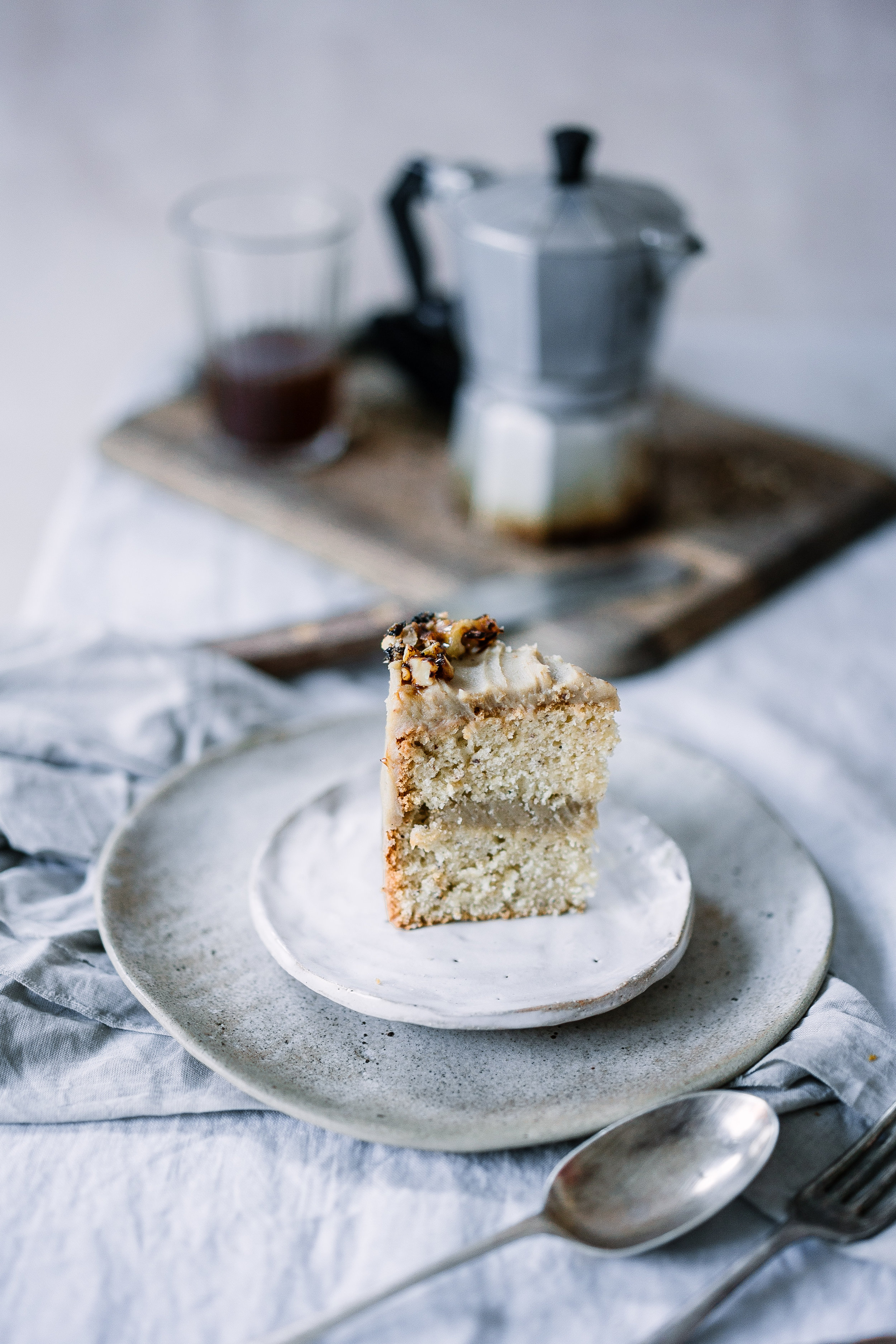 INGREDIENTS  DRY  350 g white unbleached all porpuse wheat flour 100 g icing sugar 1/4 tsp sea salt 1 Tbsp baking powder, heaped    WET  2 Tbsp flax meal + 6 Tbsp water (90ml) 100 ml extra virgin coconut oil  250 ml almond or oat milk  2 tsp of pure vanilla extract 1 lemon the zest only   Frosting:   2-3 medium white sweet potatoes  200 gr cooked chestnuts 50 gr cocoa butter, melted 50 gr raw sugar  2 Tbsp good quality coffee liqueur a dash of vanilla   METHOD Turn the oven at 180°C. Grease 3 tins of 10 cm with olive oil.  - Mix the 2 Tbsp flax meal + 6 Tbsp water in a small glass. Set aside for 5 minutes. - In a large bowl mix all the dry ingredients together - In a jar mix the liquid ingredients together - Add the flax seeds to the liquid ingredients - In a large bowl incorporate the dry with the wet, gently folding them together - Pass the batter into the tins - Cook for 30-40 minutes. Set aside to cool   WHILE COOKING:  Melt the cocoa butter in a bain-marie. Meanwhile, wash and peel the potatoes and cut into chunks.Steam the potatoes for 15-20 minutes in a steamer (or roast whole potatoes 30-40 min).  Add  all  the frosting ingredients to the food processor. Blend into a smooth cream. The frosting should be thick, however if necessary add some spoons of milk to keep the food processor running. Put the frosting into fridge overnight or for few hours until is thick enough to decorate the cake  ASSEMBLING THE CAKE:  Assemble the cake when the cake has cooled down and the frosting is solid enough to be spread. If the cakes are ronded cut the round top with a very sharp knife.  Place the first cake on your serving plate and spread a scoop of frosting on it, enough to have a good thick filling ( 1cm at least), place the second cake, repeat. And last the third cake on top, but upside down so the perfect bottom become the top of the cake.  Scoop some frosting on the top and with a spatula start spreading to the sides and down around the cake.  If the cake is fragile sta