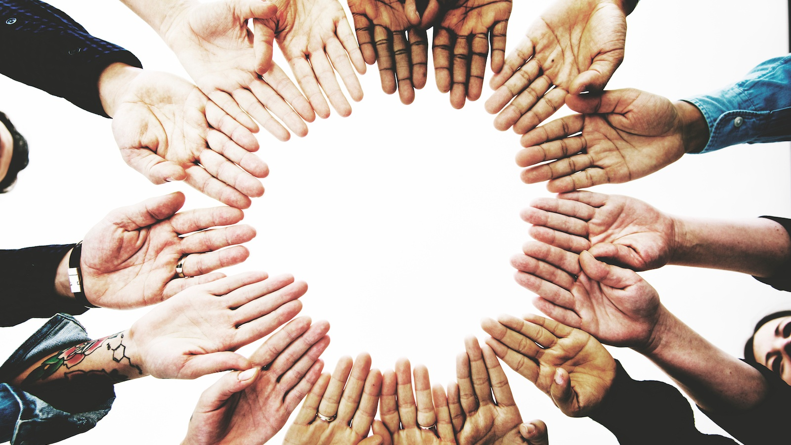 diverse-people-hands-together-partnership-P5VZKPZ.jpg