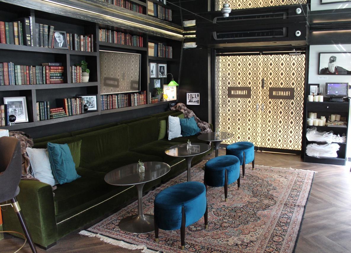 Quaint library space near the bar