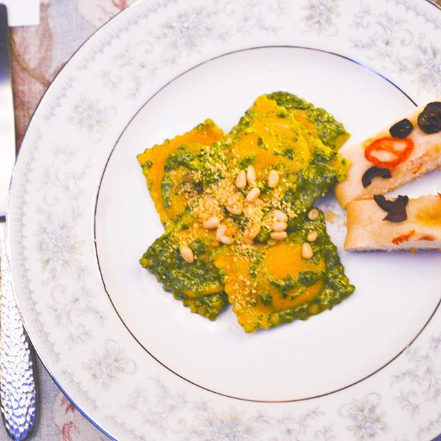 For the main course I wanted a challenge… ravioli was that and more! For the Carrot Dough I used @abitwholesomely recipe. Filling and pesto recipes below! ⁣⁣ .⁣⁣ .⁣⁣ .⁣⁣ .⁣⁣ .⁣⁣ Almond and Tofu Ricotta (adapted from @itdoesnttastelikechicken) ⁣⁣ 🌸1 tbsp olive oil ⁣⁣ 🌸1 yellow onion, chopped ⁣ 🌸 1 cup chopped white mushrooms ⁣ 🌸2 cloves garlic, minced ⁣⁣ 🌸1 block extra-firm tofu, drained⁣⁣ 🌸1/4 cup slivered almonds, soaked in boiling water⁣⁣ 🌸1/4 cup lemon juice⁣⁣ 🌸2 tbsp nutritional yeast ⁣⁣ 🌸1 tbsp white miso paste ⁣⁣ 🌸1/2 tsp salt ⁣⁣ ⁣⁣ 🍽 Combine two cups of boiled water with slivered almonds. Set aside. Heat oil in pan over medium-high heat. Sauté onion and garlic until the onions are translucent. Add chopped mushrooms and cook for 5 minutes. Break up the tofu and add it to a food processor or blender. Add the sauted onions, mushrooms and garlic along with drained slivered almonds and remaining ingredients. Blend until smooth then scrape into a bowl and let sit in fridge until ready to use. I recommend letting it sit for a day or more to absorb all the flavors. ⁣⁣ ⁣⁣ Vegan Spinach Pesto (adapted from @nytcooking)⁣⁣ 🌸1 cup fresh basil leaves (no stems) ⁣⁣ 🌸1 cup spinach ⁣⁣ 🌸2 tbsp pine nuts or slivered almonds⁣⁣ 🌸1 clove garlic ⁣⁣ 🌸1 tbsp lemon juice ⁣⁣ 🌸1/2 cup olive oil ⁣⁣ 🌸1/2 cup nutritional yeast ⁣⁣ ⁣⁣ 🍽Add all ingredients to a food processor or blender. Blend until desired consistency is reached. Add more or less basil, garlic, oil, or nutritional yeast depending on preference. ⁣⁣ .⁣⁣ .⁣⁣ .⁣⁣ .⁣⁣ .⁣⁣ .⁣⁣ .⁣⁣ .⁣⁣ .⁣⁣ .⁣⁣ .⁣⁣ .⁣⁣ #ravioli #wholefoods #healthyrecipes #recipe #summer #pesto #recipes #dinnerideas #foodstagram #foodphotography #foodpics #foodblogger #huffposttaste #foodandwine #lifeandthyme #bonappetite #plantbased #vegan #igfood #nomnomnom #nytcooking ⁣