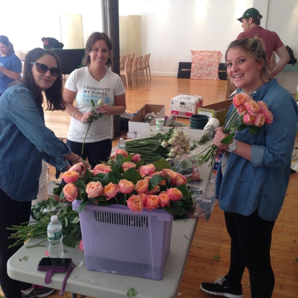 Emily and Kristen cleaning flowers