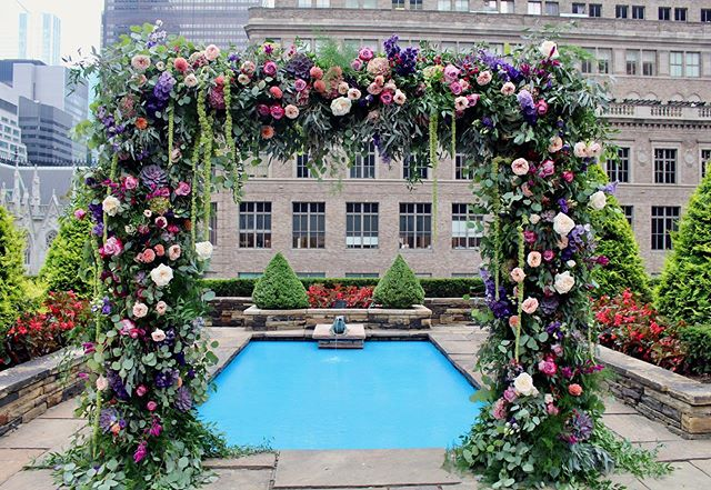 What's more romantic than a rooftop wedding in New York City? Last week, a lovely couple said 'I do' in front of a whimsical floral and greenery arch #bfloralnyc #floraldesign #weddingarch