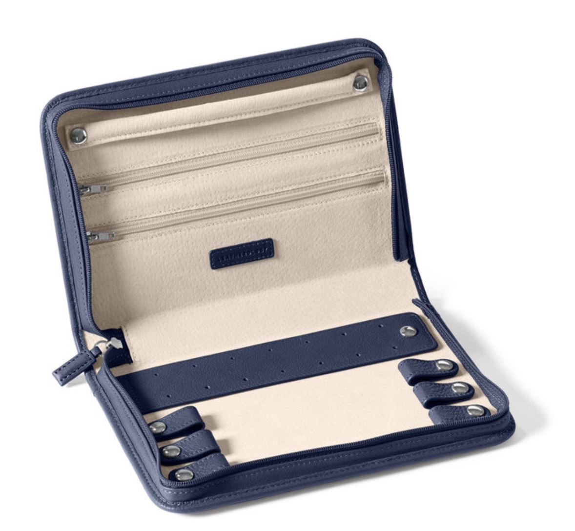 If you're a jewelry fan and don't want travel to get you down, consider this hard-shell leather jewelry organizer. Its very well-made and the zippers and snaps are heavy duty. The case will keep your jewelry protected and even has a hole-punch strap for keeping earrings safe. It's also available in many beautiful colors. Don't forget: Always keep your jewelry with you in your carry-on while traveling - never leave in your checked bags!  (LEATHEROLOGY: $85)